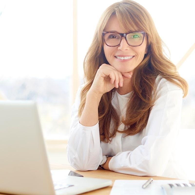 Businesswoman sitting front laptop