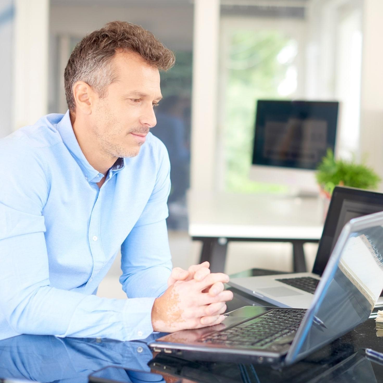 Businessman sitting front laptop